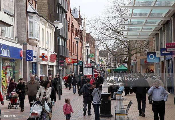People walk around Swindon city centre on the day Alistair Darling's final budget is to be announced on March 24 2010 in Swindon England The...