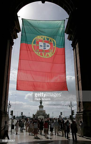 People walk around Terreiro do Paço Square to celebrate the centenary of the Portuguese Republic in Lisbon on October 5, 2010. The Portuguese...