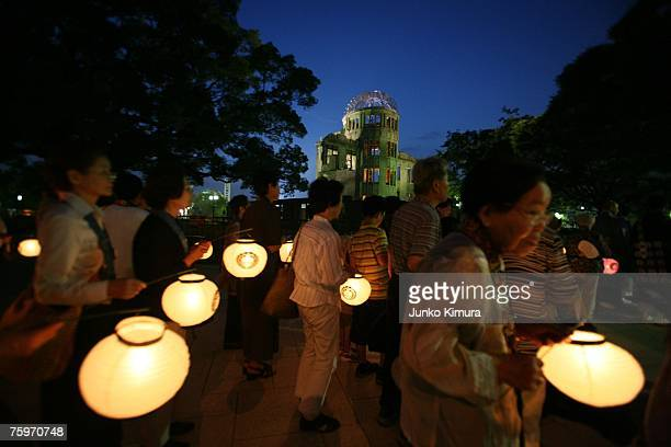 People walk around the atomic bomb dome at the Peace Memorial Park to wish for peace on the 62st anniversary eve on August 5 2007 in Hiroshima Japan...