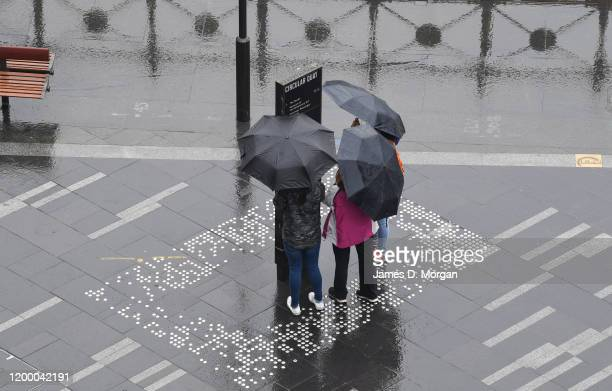 People walk around the city with their umbrellas for the first time in months on January 17 2020 in Sydney Australia A severe thunderstorm warning...