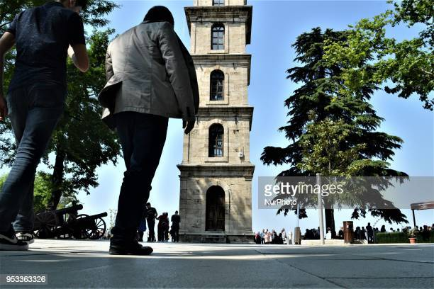 People walk around the clock tower in Tophane Park in northwestern Bursa province of Turkey on May 1 2018 Turkey prepares to go to the polls for the...