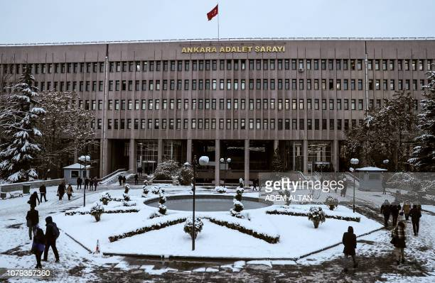 People walk around the courtyard in front of the courthouse in Ankara on January 8 2019 where opens today the trial of twentyeight suspects over the...