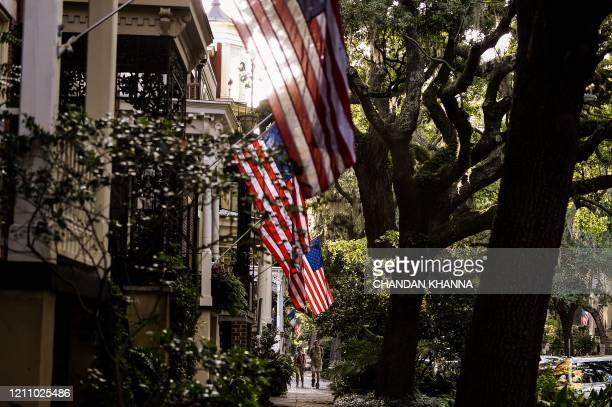 People walk around the Historic District in Savannah, Georgia, amid the novel coronavirus pandemic on April 25, 2020. - After being locked down for...