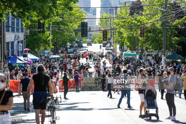 People walk around the newly created Capitol Hill Autonomous Zone in Seattle Washington on June 11 2020 The area surrounding the East Precinct...