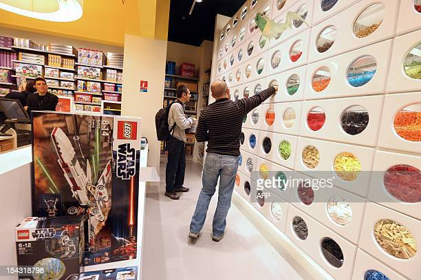 People walk around the newlyopened store of Danish construction toys group Lego on October 18 2012 at the 'So Ouest' shopping center in...