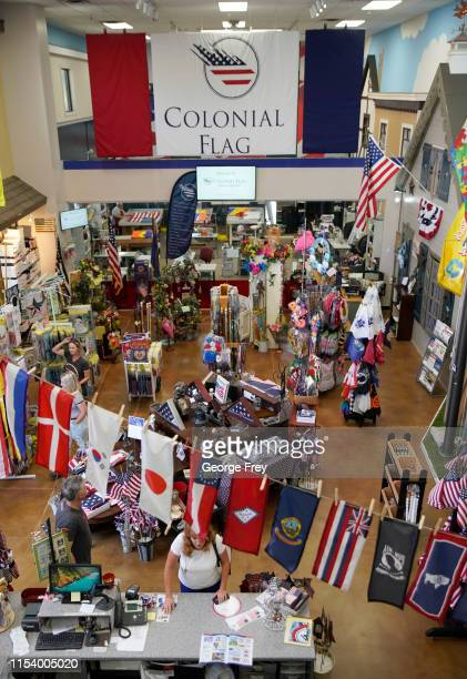 People walk around the showroom where new Betsy Ross flags are sold at Colonial Flag on July 5, 2019 in Salt Lake City, Utah. The Betsy Ross Flag...
