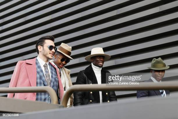 People walk at 93 Pitti Immagine Uomo at Fortezza Da Basso on January 8 2018 in Florence Italy