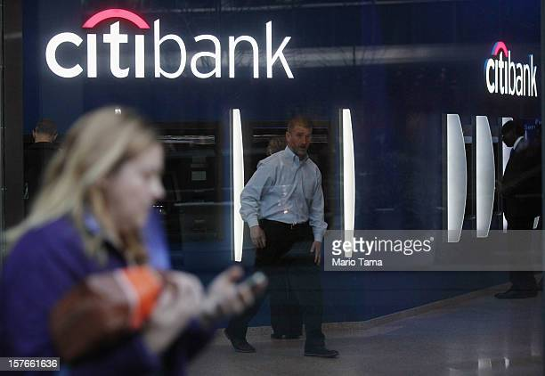 People walk at a Citibank branch at Citibank headquarters in Manhattan on December 5, 2012 in New York City. Citigroup Inc. Today announced it was...