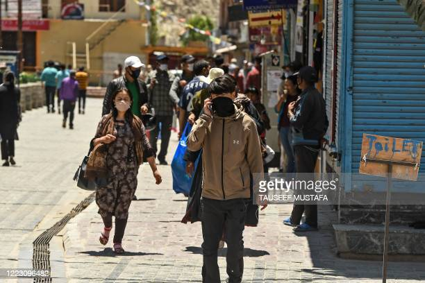 People walk at a market in Leh, the joint capital of the union territory of Ladakh, on June 27, 2020.