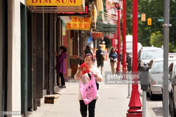 People walk at Chinatown on May 28 2020 in Vancouver Canada The Coronavirus pandemic has spread to many countries across the world claiming over...