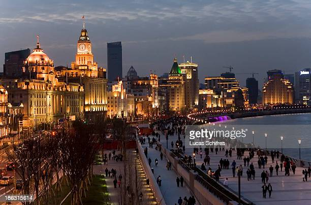 People walk at dusk on famous and newlyrenovated Bund promenade on April 2 2010 in Shanghai China Shanghai's Bund reopened on March 28 after a...