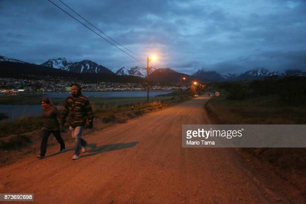 People walk at dusk on November 1 2017 in Ushuaia Argentina Ushuaia is situated along the southern edge of Tierra del Fuego in the Patagonia region...