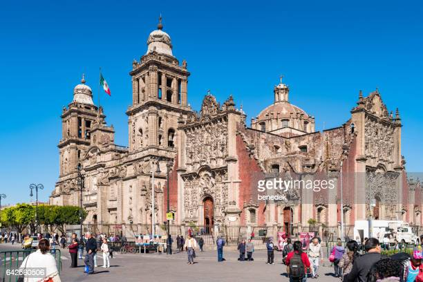 People walk at Metropolitan Cathedral Zocalo Square Downtown Mexico City
