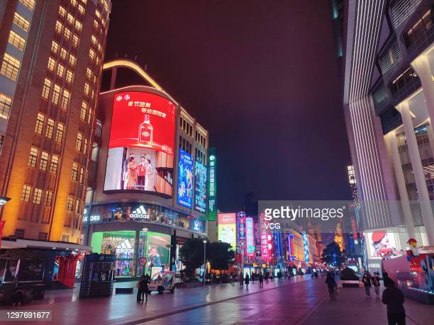 People walk at Nanjing road pedestrian zone on January 21, 2021 in Shanghai, China.