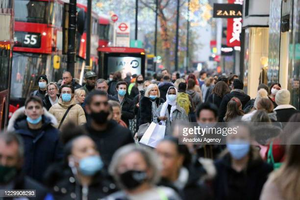 People walk at Oxford street as all non-essential shops open after national lockdown imposed to curb the spread of the coronavirus , formally lifted...