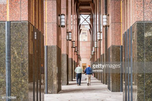 people walk at the arcade of humana building in louisville kentucky usa - humana stock pictures, royalty-free photos & images