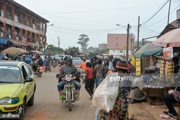 People walk at the food market in Bamenda on November 15 after a homemade bomb exploded overnight on November 12 Authorities in Cameroon have imposed...