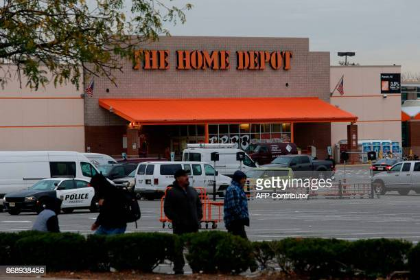 People walk at the Home Depot store where suspect Sayfullo Saipov rented a truck on November 1 in Passaic New Jersey A pickup driver killed eight...