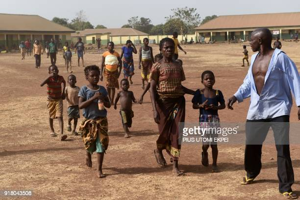 People walk at the internally displaced people camp occupied largely by women and children affected by herders and farmer's violent clashes from Logo...