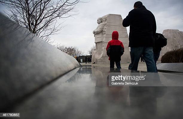 People walk at the Martin Luther King Jr Memorial on the National Mall on MLK Day January 19 2015 in Washington DC Martin Luther King day was marked...