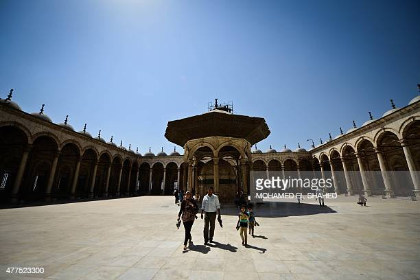 People walk at the Mohammed Ali mosque inside the Salaheddine Citadel in the Egyptian capital Cairo on June 17 2015 AFP PHOTO / MOHAMED ELSHAHED
