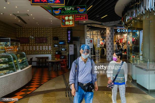 People walk at the Peak Galleria during a coronavirus outbreak on March 26 2020 in Hong Kong China Latest statistics showed Hong Kong tourist...