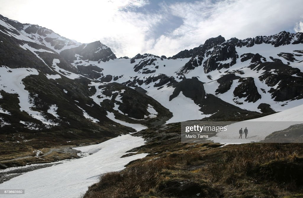 People walk at the retreating Martial Glacier on November 9, 2017 in Ushuaia, Argentina. Ushuaia is situated along the southern edge of Tierra del Fuego, in the Patagonia region, and is commonly known as the 'southernmost city in the world'. The city's main fresh water supply comes from the retreating Martial Glacier, which may be at risk of disappearing. In a 2015 report, warming temperatures led to the loss of 20 percent of the mass and surface of glaciers in Argentina over the previous 50 years, according to Argentina's Institute of Nivology, Glaciology and Environmental Sciences (IANIGLIA). Ushuaia and surrounding Tierra del Fuego face other environmental challenges including a population boom leading to housing challenges following an incentivized program attracting workers from around Argentina. Population in the region increased 11-fold between 1970 and 2015 to around 150,000. An influx of cruise ship tourists and crew, many on their way to Antarctica, has also led to increased waste and pollution in the area sometimes referred to as 'the end of the world'.