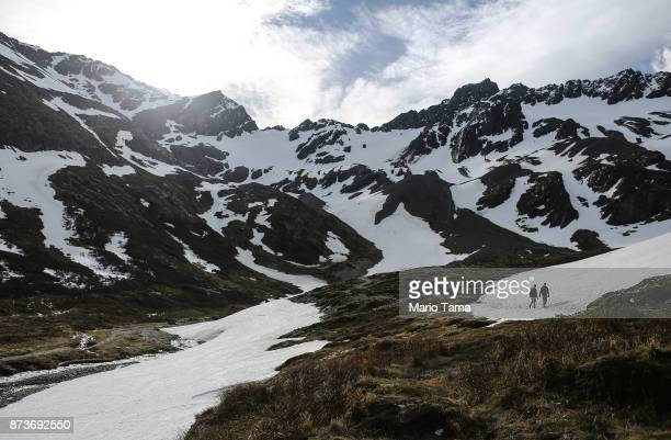 People walk at the retreating Martial Glacier on November 9 2017 in Ushuaia Argentina Ushuaia is situated along the southern edge of Tierra del Fuego...