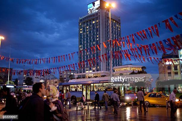 People walk at the Taxim Square in front of the Marmara Hotel in the district Beyoglu on October 16, 2009 in Istanbul, Turkey. The Turkish metropolis...