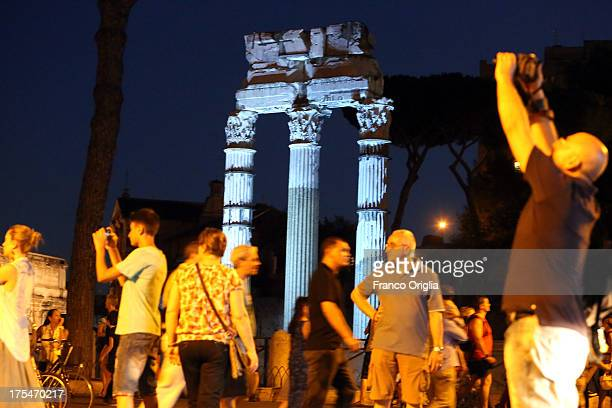 People walk at Via dei Fori Imperiali during 'La Notte dei Fori' on August 3 2013 in Rome Italy 'La Notte dei Fori' opens the plan to ban private...