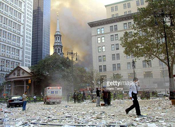 People walk away from the area where the World Trade Center buildings collapsed September 11 2001 after two airplanes slammed into the twin towers in...