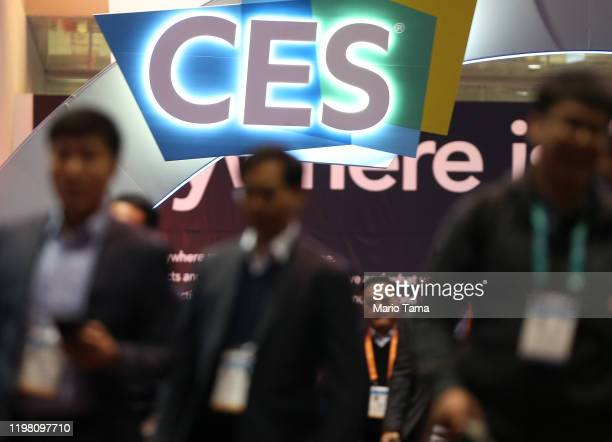 People walk beneath the CES logo at CES 2020 at the Las Vegas Convention Center on January 7, 2020 in Las Vegas, Nevada. CES, the world's largest...