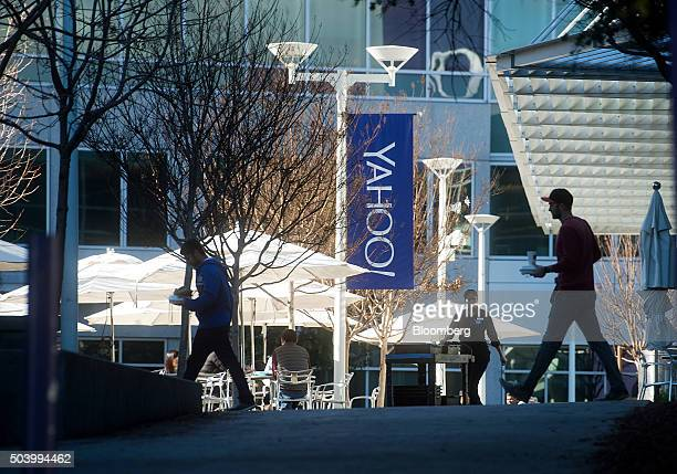 People walk between buildings on the Yahoo Inc headquarters corporate campus in Sunnyvale California US on Thursday Jan 7 2016 Yahoo Inc is planning...