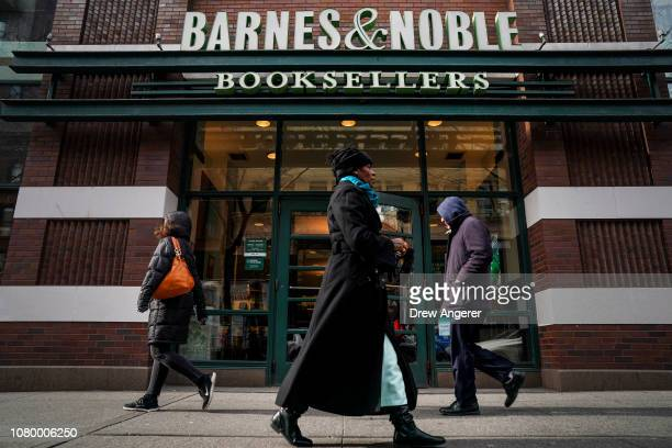 People walk by a Barnes Noble bookstore January 10 2019 in the Brooklyn borough of New York City On Thursday Barnes Noble Inc cautioned investors...
