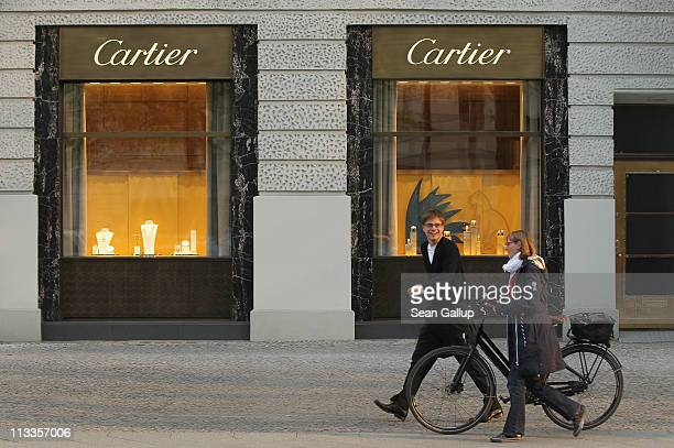 People walk by a Cartier luxury goods store on Kurfuerstendamm avenue on April 27 2011 in Berlin Germany Kurfuerstendamm known locally as Ku'damm and...