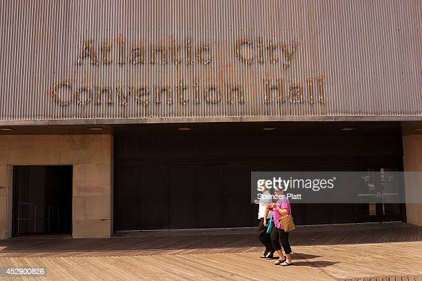 People walk by a convention center on the boardwalk in Atlantic City on July 29 2014 in Atlantic City New Jersey Since January of 2014 four of...