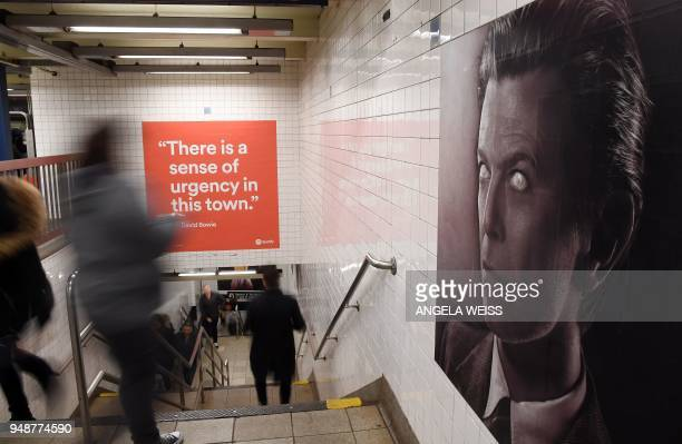 People walk by a David Bowie art installation seen at the BroadwayLafayette subway station on April 19 2018 in New York City The subwaywallsized...