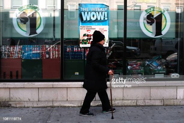 People walk by a Dollar Tree store on December 11 2018 in the Brooklyn borough of New York City As the income gap between rich and poor continues to...