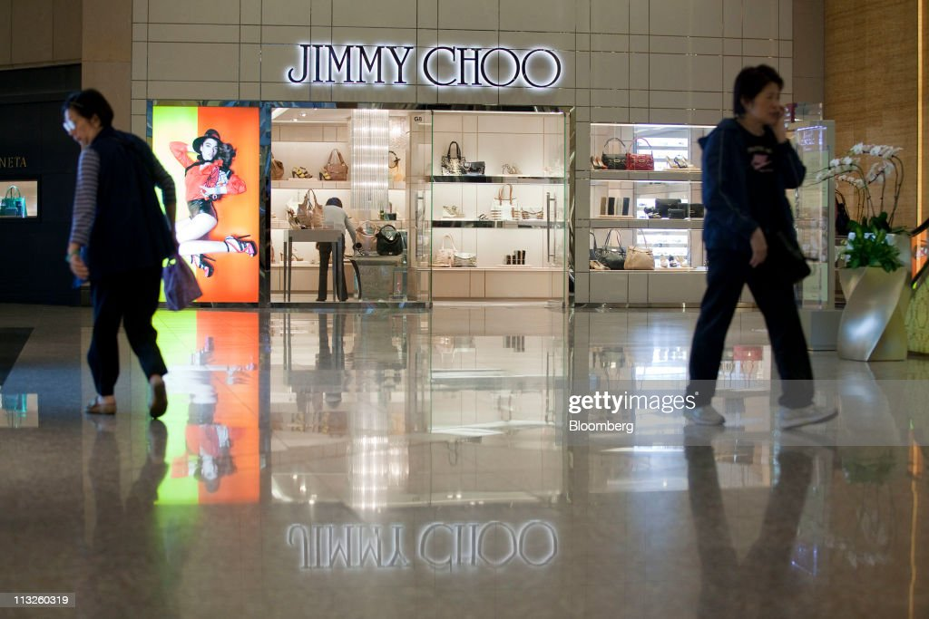 1f05e47984f People walk by a Jimmy Choo Ltd. retail store in a shopping mall in ...