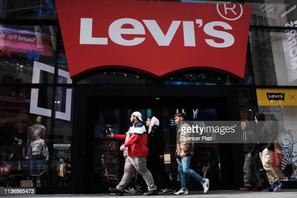 People walk by a Manhattan Levi's clothing store on March 19 2019 in New York City The iconic American blue jeans maker Levi Strauss Co is expected...