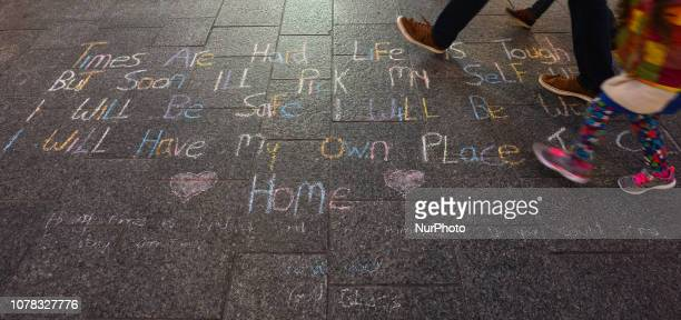 People walk by a message left by a homeless person on Dublin's Grafton Street quotTimes Are Hard Life Is Tough But Soon I'll Pick My Self Up I Will...