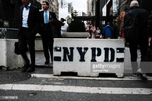 People walk by a police cinder block on November 05 2019 in New York City Following a turbulent threeyear run as Police Commissioner James O'Neill...