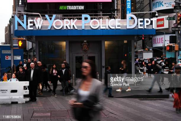 People walk by a police substation in Times Square on November 05 2019 in New York City Following a turbulent threeyear run as Police Commissioner...