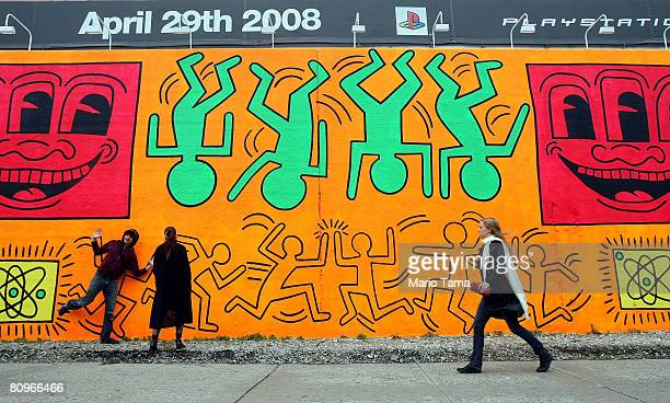 People walk by a recreation of an untitled mural painted by artist Keith Haring on the corner of Houston Street and Bowery in Manhattan May 2 2008 in...