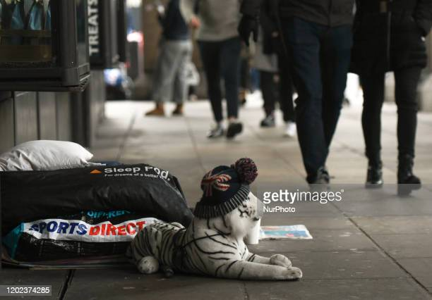 People walk by a rough sleeper near Westminster Palace in Central London On Saturday 25 January 2019 in London United Kingdom
