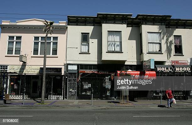 People walk by a row of closed businesses in the Mission District as store owners elected to closed their businesses to protest for immigrant rights...