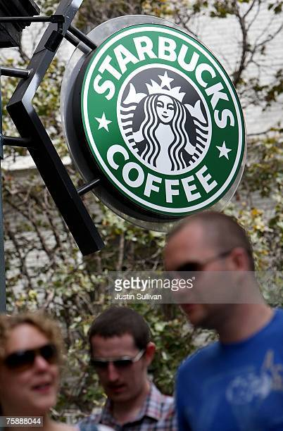 People walk by a Starbucks store July 31, 2007 in San Francisco, California. With dairy prices reaching record highs, Starbucks announced that it...