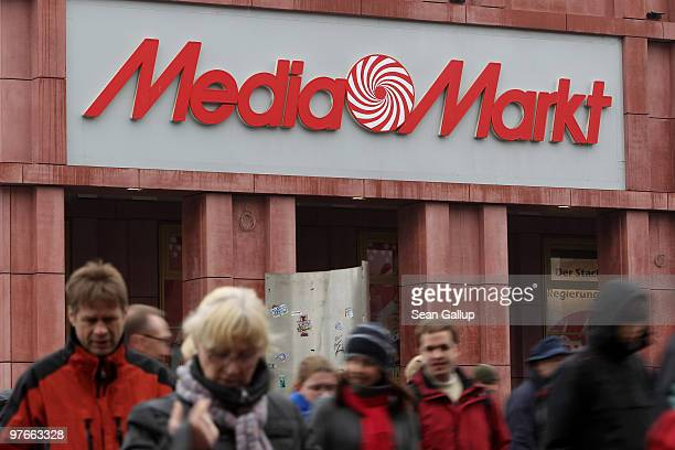 People walk by a store of German consumer electronics retail chain Media Markt on March 12 2010 in Berlin Germany Media Markt is owned by Metro Group...