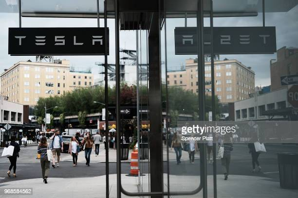People walk by a Tesla showroom in the Meatpacking district in Manhattan on June 6 2018 in New York City Tesla stock had its best day since November...
