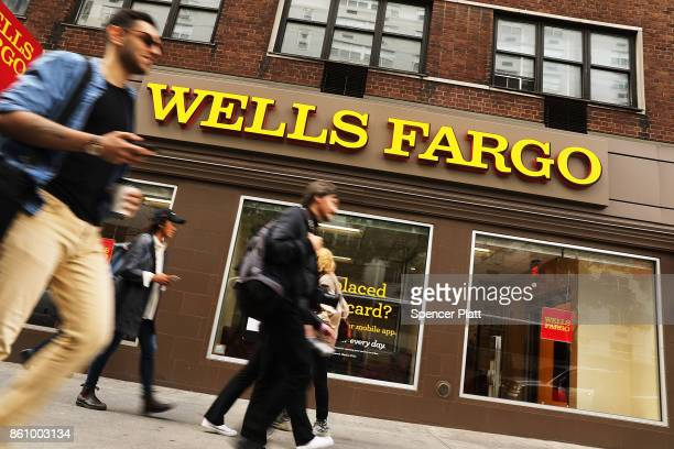 People walk by a Wells Fargo bank branch on October 13 2017 in New York City Wells Fargo shares were down 34% toÊ$5334Êin afternoonÊtrading following...